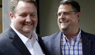 FILE - In this Nov. 15, 2016, file photo, Curt Freed, left, and his husband Robert Ingersoll, the couple who sued florist Barronelle Stutzman for refusing to provide services for their wedding, smile after a hearing before Washington's Supreme Court in Bellevue, Wash. The Washington Supreme Court on Thursday, Feb. 16, 2017, has unanimously ruled that Stutzman, broke the state's antidiscrimination law.  Stutzman said she was exercising her First Amendment rights, and her lawyers immediately said they would ask the U.S. Supreme Court to overturn the decision. (AP Photo/Elaine Thompson, File)