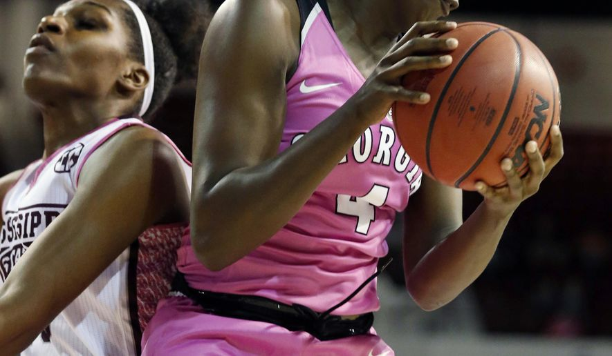 Georgia forward Caliya Robinson (4) pulls down a rebound in front of Mississippi State center Teaira McCowan (15) in the first half of an NCAA college basketball game in Starkville, Miss., Thursday, Feb. 16, 2017. (AP Photo/Rogelio V. Solis)
