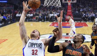 Los Angeles Clippers forward Blake Griffin, left, and Atlanta Hawks center Dwight Howard reach for a rebound during the first half of an NBA basketball game, Wednesday, Feb. 15, 2017, in Los Angeles. (AP Photo/Mark J. Terrill)