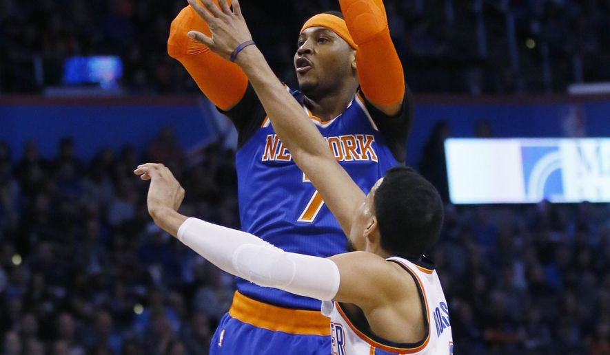 New York Knicks forward Carmelo Anthony (7) shoots over Oklahoma City Thunder forward Andre Roberson during the first quarter of an NBA basketball game in Oklahoma City, Wednesday, Feb. 15, 2017. (AP Photo/Sue Ogrocki)