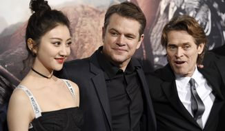 "Jing Tian, from left, Matt Damon, and Willem Dafoe, cast members in ""The Great Wall,"" pose together at the premiere of the film at the TCL Chinese Theatre on Wednesday, Feb. 15, 2017, in Los Angeles. (Photo by Chris Pizzello/Invision/AP)"