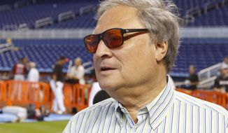 """FILE - In this April 7, 2015, file photo, Miami Marlins owner Jeffrey Loria speaks with reporters before the Marlins met the Atlanta Braves in a baseball game in Miami.  The Kushner family, which has close ties to the White House, has put the brakes on its negotiations to buy the Marlins because of a report team owner Jeffrey Loria may be nominated by President Trump to become ambassador to France. Joshua Kushner, whose older brother is an adviser to the president, has a preliminary agreement to buy the Marlins. But in a statement released late Wednesday, Feb. 15, 2017,  by Kushner's brother-in- law, Joseph Meyer, the family expressed concern the deal might """"complicate"""" the ambassadorship appointment. (AP Photo/Joe Skipper, File)"""