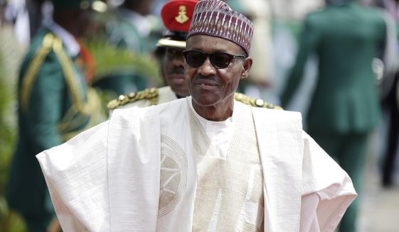 FILE- In this file photo taken Friday, May 29, 2015, Nigerian President elect, Muhammadu Buhari, arrives for his Inauguration at the eagle square in Abuja, Nigeria. Nigerian President Muhammadu Buhari's nearly month-long medical leave in London is reminding his country's taxpayers that while they finance their leaders' health care abroad, they often are stuck with decrepit, ill-staffed government health facilities at home. (AP Photo/Sunday Alamba, File)
