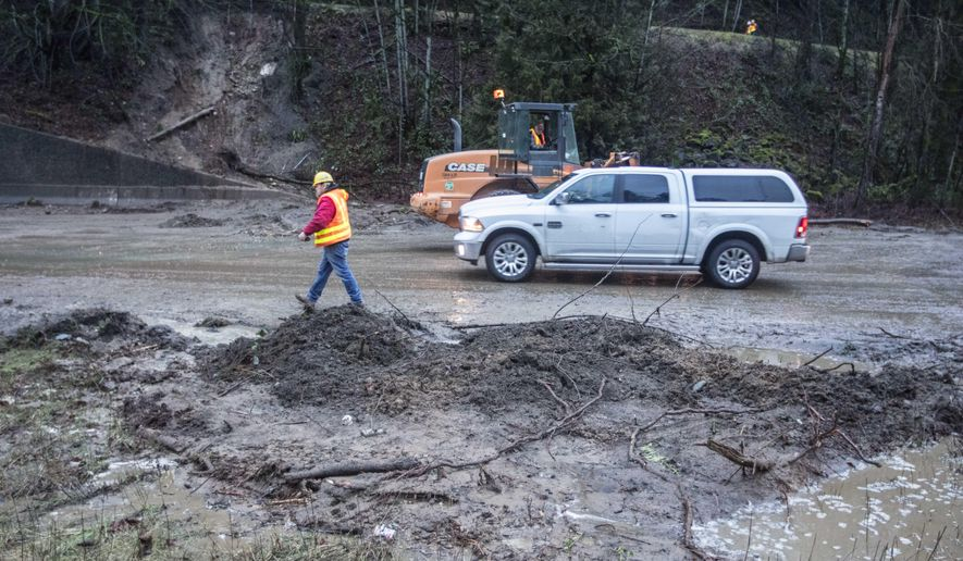 A mudslide blocks westbound lanes of Interstate 90 in Issaquah, Wash. on Thursday, Feb. 16, 2017. Several cars were stuck in the mud. No injuries were reported.After a week of snow and heavy rains, landslides were covering roads around Seattle Thursday while in Spokane County a state of emergency was declared for flooding and washed out roadways. (Steve Ringman / The Seattle Times via AP)