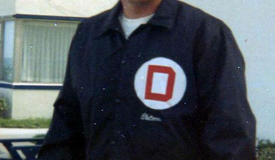 """In this 1970 family photo provided by Lori Cooper, Columbus, Ohio, police officer Niki Cooper poses in his """"Company D"""" jacket signifying his membership in a unit of officers that worked an 8 p.m. to 4 a.m. swing shift during the police department's busiest hours. An 82-year-old man who was indicted, but never prosecuted, in the nonfatal shooting of Cooper almost 45 years ago cannot be tried now, a judge ruled Thursday, Feb. 16, 2017. Cooper, who died just over three years ago at 71, rarely spoke of the event and his family said he was never the same afterward. (Photo courtesy of Lori Cooper via AP)"""