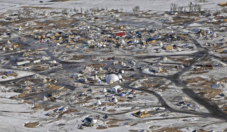 This aerial photo shows the Oceti Sakowin camp, where people have gathered to protest the Dakota Access pipeline on federal land, Monday, Feb. 13, 2017, in Cannon Ball, N.D. A federal judge on Monday refused to stop construction on the last stretch of the Dakota Access pipeline, which is progressing much faster than expected. (Tom Stromme/The Bismarck Tribune via AP)