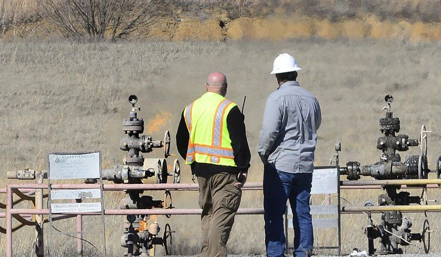 Kevin Enloe, director of McAlester/Pittsburg County Emergency Management, left, stands near the scene of an oil field explosion near Quinton, Okla., in Pittsburg County, Thursday, Feb. 16, 2017. (Kevin Harvison/The McAlester News-Capital via AP)