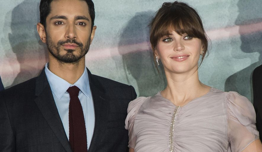 "Riz Ahmed, left, and Felicity Jones at the premiere of the film ""Rogue One: A Star Wars Story"" in London, Dec. 13, 2016. Ahmed and Jones will serve as presenters at the Oscars ceremony on Feb. 26. (Photo by Vianney Le Caer/Invision/AP) ** FILE **"