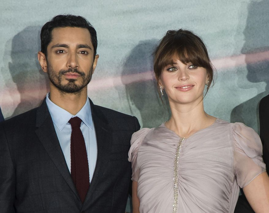 """Riz Ahmed, left, and Felicity Jones at the premiere of the film """"Rogue One: A Star Wars Story"""" in London, Dec. 13, 2016. Ahmed and Jones will serve as presenters at the Oscars ceremony on Feb. 26. (Photo by Vianney Le Caer/Invision/AP) ** FILE **"""