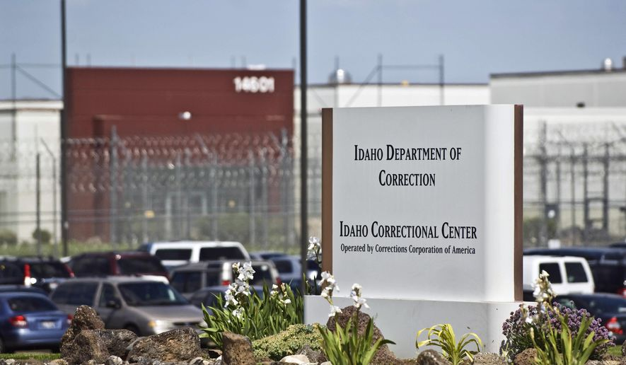 FILE - In this June 15, 2010 file photo, the Idaho Correctional Center is shown south of Boise, Idaho, operated by Corrections Corporation of America. A former regional manager for Corrections Corporation of America says top employees at the private prison in Idaho were given yearly bonuses if they cut costs on salary, wages and other operational expenses and met other company goals. (AP Photo/Charlie Litchfield, File)