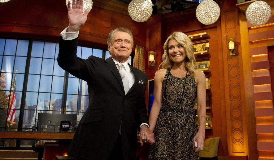 """FILE - In this Friday, Nov. 18, 2011, file photo, Regis Philbin and Kelly Ripa appear on Regis' farewell episode of """"Live! with Regis and Kelly"""", in New York. Philbin said he hasn't kept in touch with Ripa, his former co-host, since he decided to leave the show they headlined together. (AP Photo/Charles Sykes, File)"""