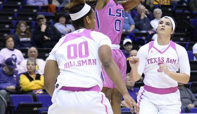 LSU guard Chloe Jackson (0) shoots over Texas A&M center Khaalia Hillsman (00) and forward Taylor Cooper (3) during an NCAA college basketball game Thursday, Feb. 16, 2017, in Baton Rouge, La. (Hilary Scheinuk/The Advocate via AP)