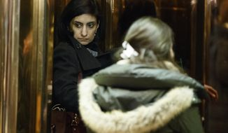 FILE - In this Jan. 10, 2017 file photo, Seema Verma, left, then President-elect Donald Trump's nominee for administrator of the Centers for Medicare and Medicaid Services, gets on an elevator in the lobby of Trump Tower in New York. Verma, the businesswoman selected by President Donald Trump to oversee Medicaid, the health care program for 74 million low-income Americans, has said the program is structurally flawed at its core by policies that burden states and foster dependency in the poor. (AP Photo/Evan Vucci File)