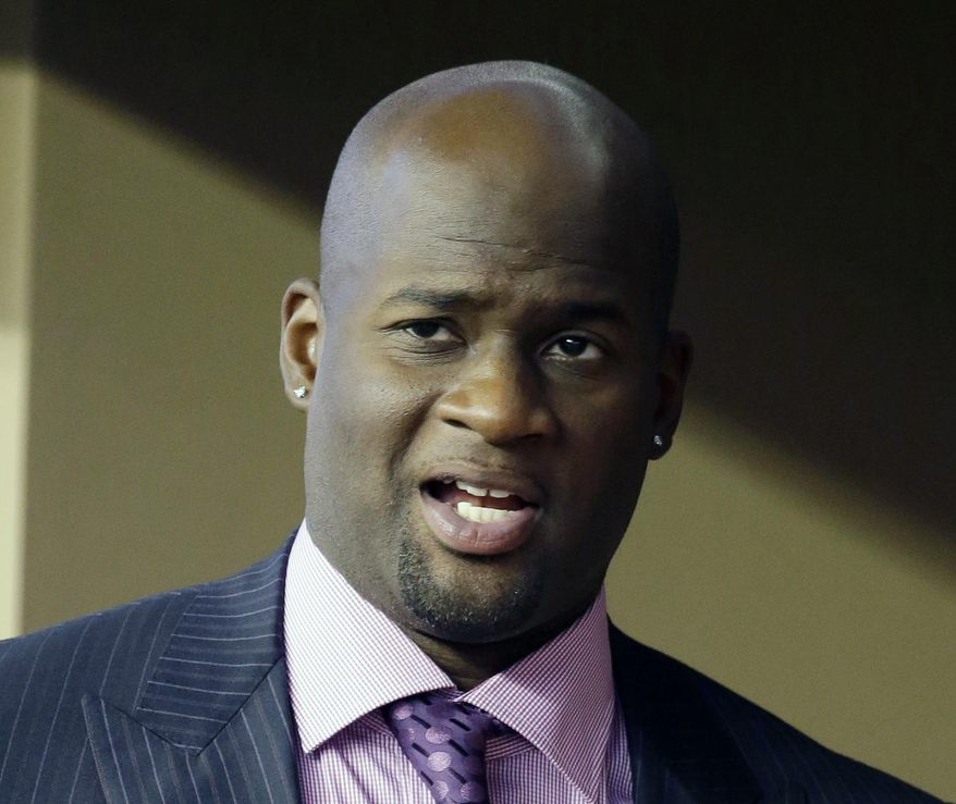 "FILE - In this Sept. 13, 2014, file photo, Vince Young is shown in a suite during a college football game in Arlington, Texas. Vince Young still isn't quite ready to call it a career. The two-time Pro Bowl quarterback has hired agent Leigh Steinberg, who welcomed his new client on Twitter on Wednesday, Feb. 15, 2017, and said Young ""has dream of playing more football, being role model.""(AP Photo/Tony Gutierrez, File)"