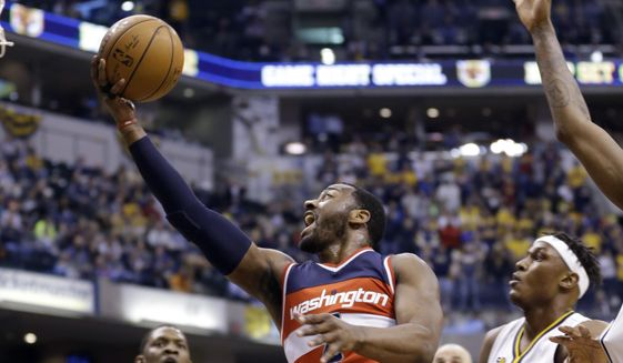 Washington Wizards guard John Wall (2) shoots in front of Indiana Pacers center Myles Turner (33) during the first half of an NBA basketball game in Indianapolis, Thursday, Feb. 16, 2017. (AP Photo/Michael Conroy)