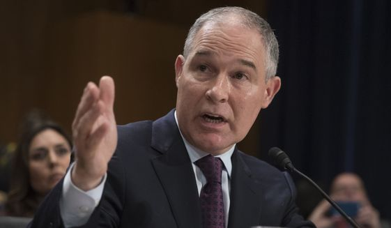 Environmental Protection Agency Administrator nominee, Oklahoma Attorney General Scott Pruitt testifies on Capitol Hill in Washington at his confirmation hearing before the Senate Environment and Public Works Committee, in this Jan. 18, 2017, file photo. (AP Photo/J. Scott Applewhite, File)