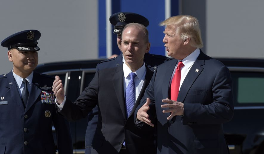 President Donald Trump talks with Boeing CEO Dennis Muilenburg upon his arrival on Air Force One at Charleston International Airport in North Charleston, S.C., Friday, Feb. 17, 2017. (AP Photo/Susan Walsh) ** FILE **