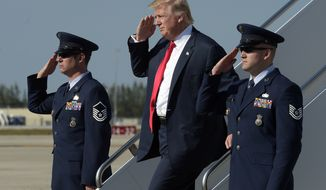 President Donald Trump salutes as he arrives a Palm Beach International Airport in West Palm Beach, Fla., Friday, Feb. 17, 2017. Trump is spending a third weekend in a row at his Mar-a-Lago estate. (AP Photo/Susan Walsh)