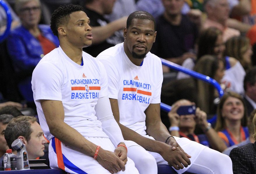 FILE - In this April 11, 2016, file photo, Oklahoma City Thunder's Russell Westbrook, left, and Kevin Durant talk during a timeout in the second half of an NBA basketball game in Oklahoma City, Okla. The next time Russell Westbrook walks into a locker room for a game, Kevin Durant will be there. Get ready for the perhaps the best subplot of All-Star Weekend. The former Oklahoma City teammates and now rivals play as Western Conference teammates Sunday night, Feb. 19, 2017. (AP Photo/Alonzo Adams, File)