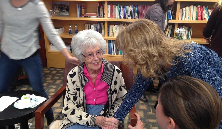 Annie Glenn, widow of astronaut  and U.S. Sen. John Glenn, speaks to a staff member of the Ohio State University John Glenn College of Public Affairs on Thursday, Feb 16, 2017, in Columbus Ohio at a party for her 97th birthday, which is Friday. (AP Photo/Julie Carr Smyth)