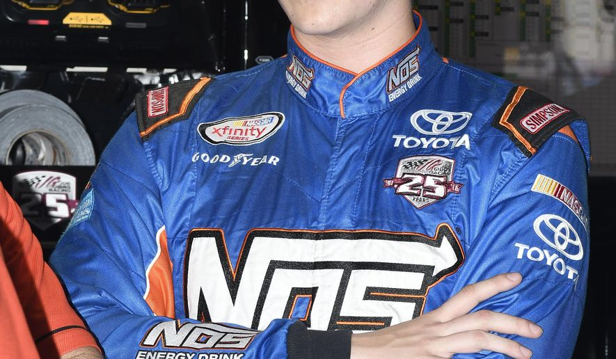 FILE - In this Nov. 4, 2016, file photo, Matt Tifft stands in the garage during auto racing practice at Texas Motor Speedway in Fort Worth, Texas. Tifft, who has a full-time ride in Xfinity Series with Joe Gibbs Racing this season, qualified second in the No. 18 Toyota for JGR and will start next to pole-sitter Tom Hessert.  (AP Photo/Larry Papke, File)