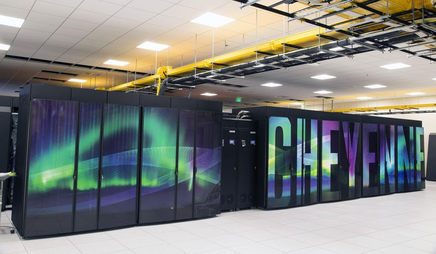 This Oct. 26, 2016 photo provided by the University Corporation for Atmospheric Research shows the new supercomputer named Cheyenne at the National Center for Atmospheric Research at the supercomputing center in Cheyenne, Wyo. Wyoming officials including Gov. Matt Mead say they support the NCAR-Wyoming Supercomputing Center even as they describe themselves as climate skeptics. Scientists nationwide are nonetheless concerned that President Donald Trump, who has called climate change a hoax, might not take climate change research seriously. (Carlye Calvin/ University Corporation for Atmospheric Research via AP)
