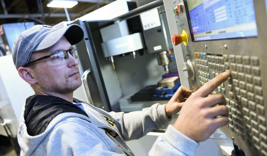 ADVANCE FOR USE SATURDAY, FEB. 18 - In this Friday, Feb. 10, 2017 photo, Mathew Resnick works with a CNC lathe during his class at the WCCC Advanced Technology Center in Tarrs, Pa. Resnick is a non-traditional student taking classes at ATC to retrain for a new career. (Christian Tyler Randolph/Pittsburgh Tribune-Review via AP)