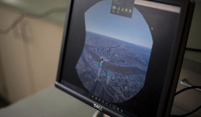 In this Friday, Feb. 10, 2017 photo, displayed is a view of downtown Pittsburgh on the screen of a part of a virtual reality set that teachers are learning with during a class at the Allegheny Intermediate Unit in Homestead, Pa. (Nate Smallwood /Pittsburgh Tribune-Review via AP)