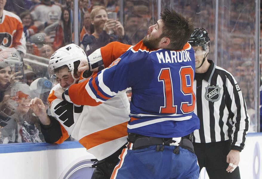 Philadelphia Flyers defeneman Brandon Manning (23) and Edmonton Oilers left wing Patrick Maroon (19) fight during the second period of an NHL hockey game Thursday, Feb. 16, 2017, in Edmonton, Alberta, (Jason Franson/The Canadian Press via AP)
