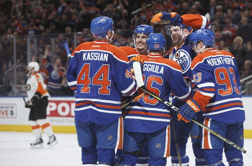 Edmonton Oilers celebrate a goal against the Philadelphia Flyers during the second period of an NHL hockey game Thursday, Feb. 16, 2017, in Edmonton, Alberta, (Jason Franson/The Canadian Press via AP)