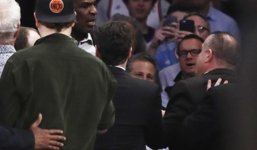 FILE - In this Wednesday, Feb. 8, 2017, file photo, former New York Knicks player Charles Oakley, rear left,exchanges words with a security guard during the first half of an NBA basketball game between the Knicks and the LA Clippers in New York. Officers with the National Basketball Players Association said Friday, Feb. 17, 2017, that the problems between Oakley and Madison Square Garden chairman James Dolan could impact decisions future free agents make about playing for the Knicks. (AP Photo/Frank Franklin II, File)