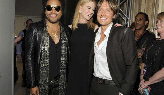 """FILE - In this June 5, 2013, file photo, musician Lenny Kravitz, left, actress Nicole Kidman and country singer Keith Urban pose at the 2013 CMT Music Awards at Bridgestone Arena in Nashville, Tenn. Kidman has revealed that she was once engaged to Kravitz. Kidman confirmed the engagement with the rocker in a recent interview with Net-A-Porter's magazine """"The Edit,"""" in which she was discussing her upcoming HBO series """"Big Little Lies."""" (Photo by Frank Micelotta/Invision/AP, File)"""