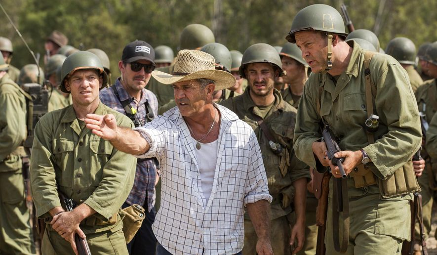 """This image released by Summit shows director Mel Gibson, center, and actor Vince Vaughn on the set of the film, """"Hacksaw Ridge."""" Gibson is nominated for an Oscar for best directing for his work on the film. (Summit via AP)"""
