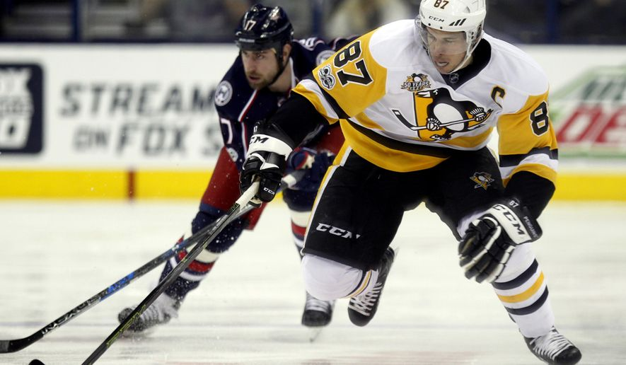 Pittsburgh Penguins forward Sidney Crosby, right, carries the puck against Columbus Blue Jackets forward Brandon Dubinsky during the first period of an NHL hockey game in Columbus, Ohio, Friday, Feb. 17, 2017. (AP Photo/Paul Vernon)