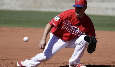 Philadelphia Phillies' Tommy Joseph fields a ball during a spring training baseball workout Thursday, Feb. 16, 2017, in Clearwater, Fla. (AP Photo/Matt Rourke)