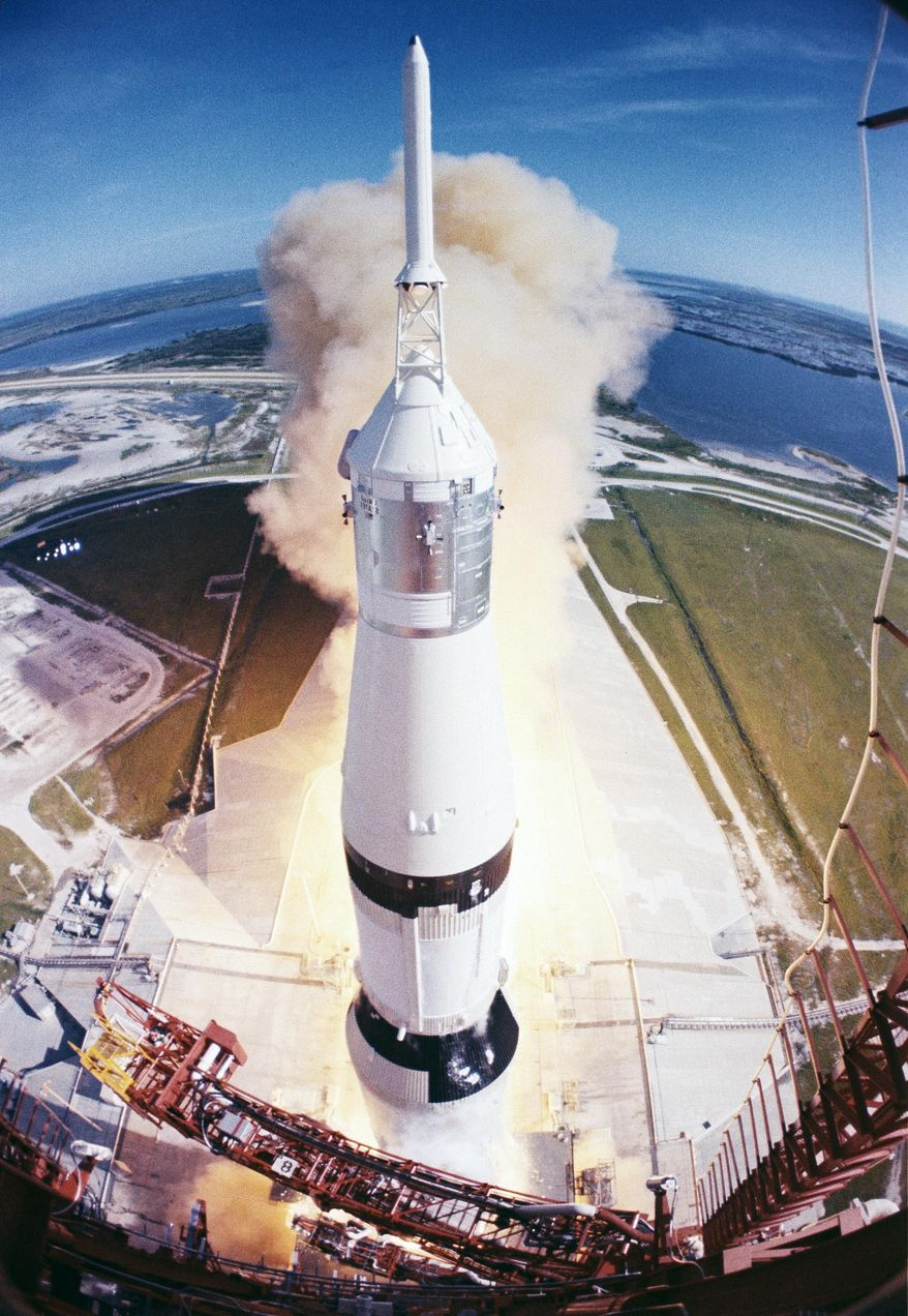 FILE - In this July 26, 1971 photo provided by NASA, the Apollo 15 space vehicle as it lifts off from Launch Complex 39A at Kennedy Space Center in Fla. Dormant for nearly six years, Launch Complex 39A at NASA's Kennedy Space Center should see its first commercial flight on Feb. 18, 2017. A SpaceX Falcon 9 rocket will use the pad to hoist supplies for the International Space Station. (NASA via AP)