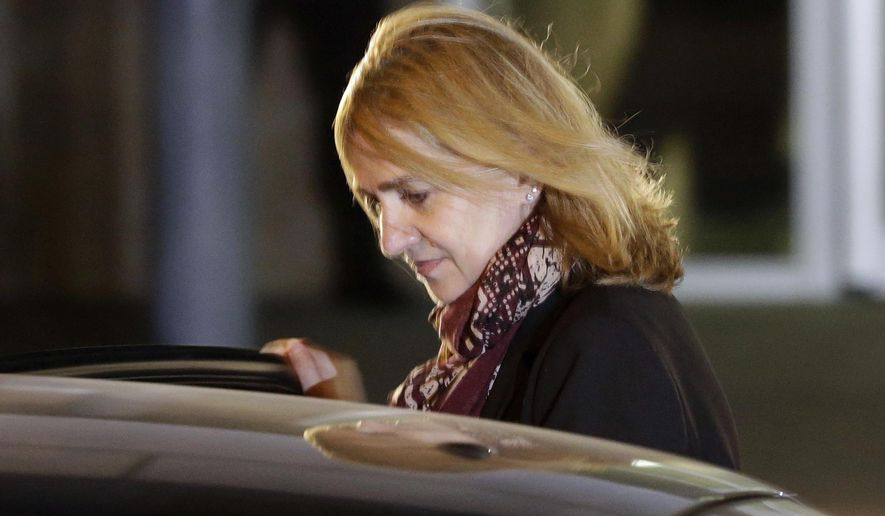 FILE - In this Jan. 11, 2016 file photo, Spain's Princess Cristina leaves a courtroom during a corruption trial, in Palma de Mallorca, Spain. A Spanish court  on Friday Feb. 17, 2017, found Princess Cristina not guilty in a tax fraud case in which her husband  Inaki Urdangarin , was sentenced Friday to 6 years and 3 months in prison for evading taxes, fraud and various other charges.  (AP Photo/Emilio Morenatti, File)