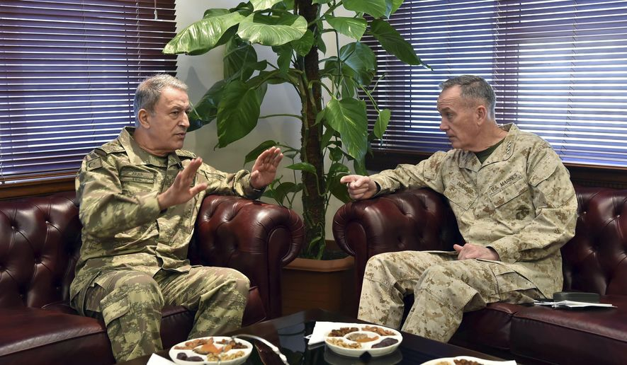 """The U.S. chairman of the Joint Chiefs of Staff, Gen. Joseph Dunford, right, and Turkey's Chief of Staff Gen. Hulusi Akar talk during a meeting in Incirlik Airbase in Adana, Turkey, Friday, Feb. 17, 2017.  Turkey's military says the Turkish and U.S. chiefs of staff have """"confirmed"""" the need to fight terror groups in Syria and Iraq, including the Islamic State group and Kurdish militants.(Turkish Military, Pool Photo via AP)"""