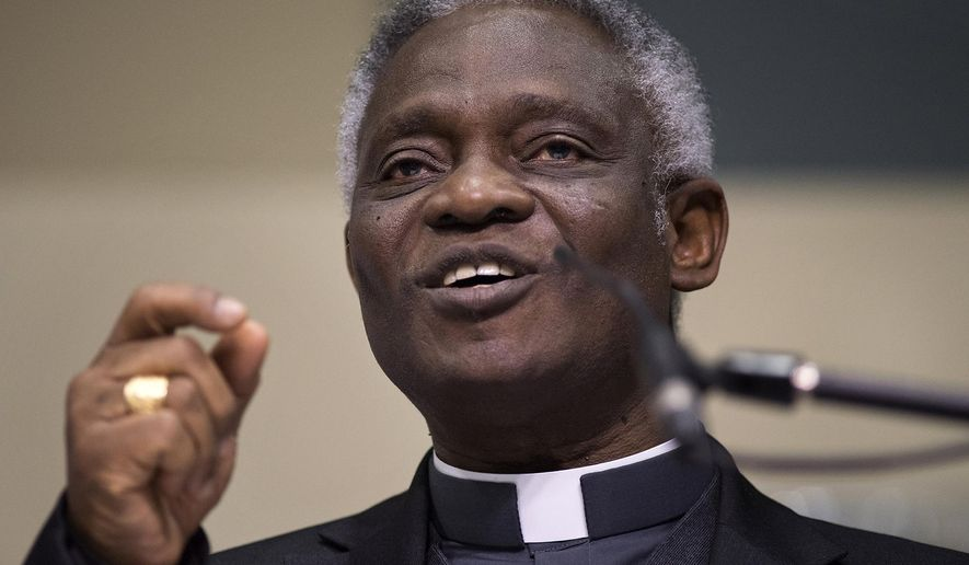Cardinal Peter Turkson delivers the keynote address at the U.S. Regional World Meeting of Popular Movements at Central Catholic High School in Modesto, Calif., Thursday, Feb. 16, 2017. The gathering of Catholic clergy and activists in Modesto, California, came as the world grapples with the impact of President Donald Trump's efforts to change U.S. immigration policy. (Andy Alfaro/The Modesto Bee via AP)