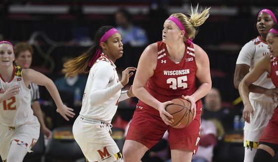 Wisconsin's Kendall Shaw, right, looks to pass as Maryland's Kiah Gillespie defends during the first half of an NCAA college basketball game, Wednesday, Feb. 15, 2017, in College Park, Md. Maryland won 89-40. (AP Photo/Gail Burton)