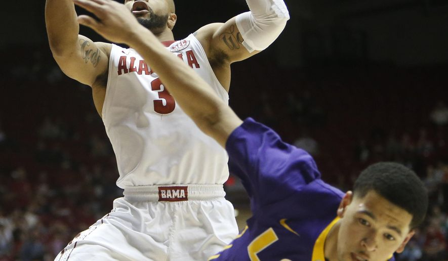 Alabama guard Corban Collins (3) tries to retain possession of the ball as he floats through the lane after LSU guard Skylar Mays (4) deflected the ball in Coleman Coliseum in Tuscaloosa, Ala., Saturday, Feb. 18, 2027. Alabama defeated LSU 90-72. (Gary Cosby Jr./The Tuscaloosa News via AP)