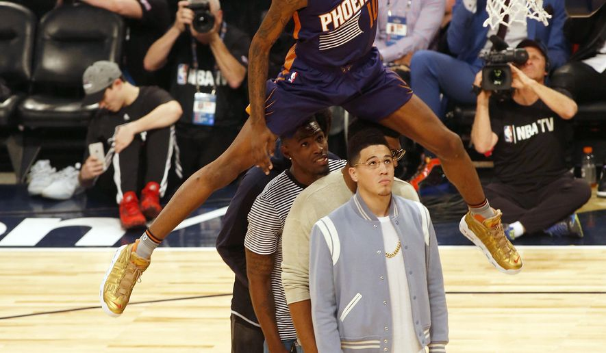 Phoenix Suns forward Derrick Jones Jr. (10) leaps over four people to make a dunk during the slam-dunk contest as part of the NBA All-Star Saturday Night events in New Orleans, Saturday, Feb. 18, 2017. (AP Photo/Max Becherer)