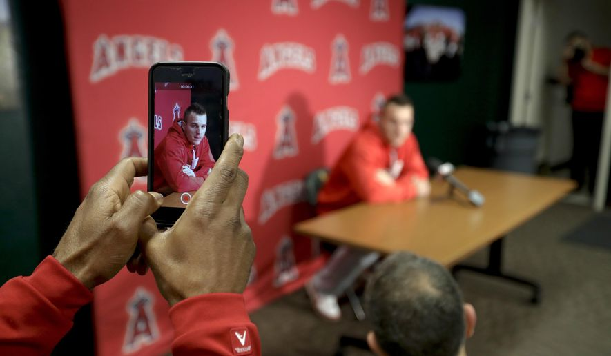 Los Angeles Angels center fielder Mike Trout speaks during a news conference at spring baseball practice in Tempe, Ariz., Saturday, Feb. 18, 2017. (AP Photo/Chris Carlson)