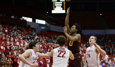 Arizona State guard Tra Holder (0) shoots over Washington State guard Malachi Flynn (22) and center Conor Clifford, left, in the first half of an NCAA college basketball game, Saturday, Feb. 18, 2017, in Pullman, Wash. (AP Photo/Ted S. Warren)