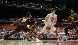 Washington State center Conor Clifford (42) drives between Arizona State guard Shannon Evans II (11) and forward Andre Adams (12) in the first half of an NCAA college basketball game, Saturday, Feb. 18, 2017, in Pullman, Wash. (AP Photo/Ted S. Warren)