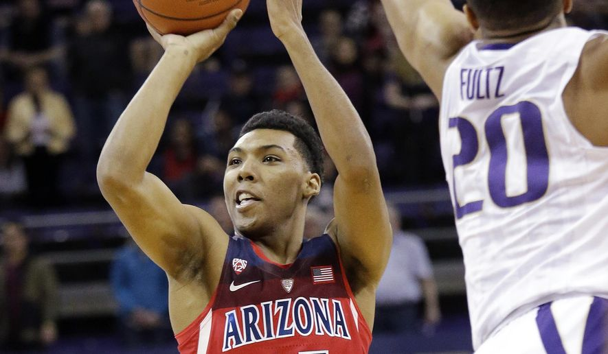 Arizona's Allonzo Trier (35) shoots as Washington's Markelle Fultz defends in the first half of an NCAA college basketball game Saturday, Feb. 18, 2017, in Seattle. (AP Photo/Elaine Thompson)