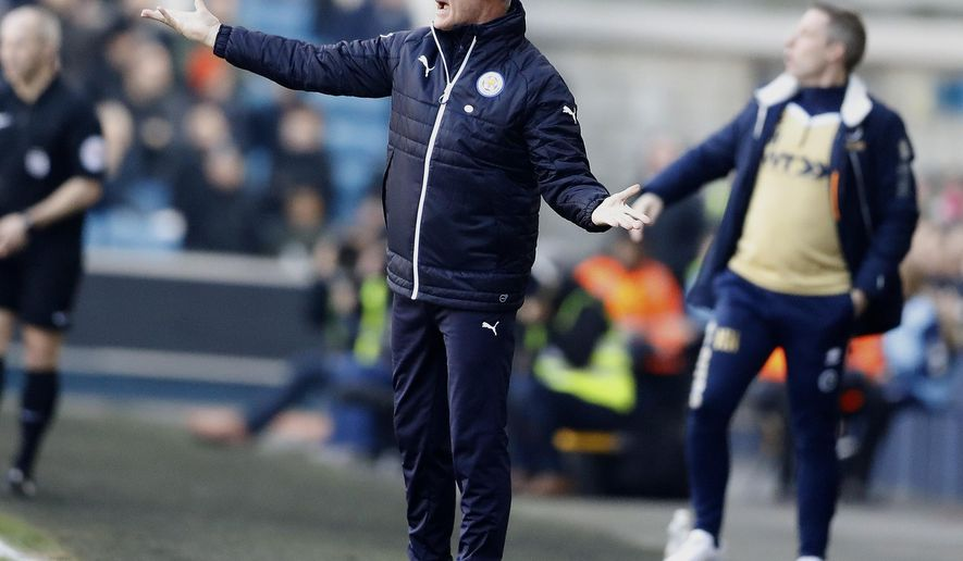 Leicester City manager Claudio Ranieri gestures during the English FA Cup soccer match between Millwall and Leicester City at The Den stadium in London, Saturday, Feb. 18, 2017. (AP Photo/Frank Augstein)