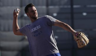 Chicago Cubs' Kris Bryant throws during a spring training baseball workout Tuesday, Feb. 14, 2017, in Mesa, Ariz. (AP Photo/Morry Gash)