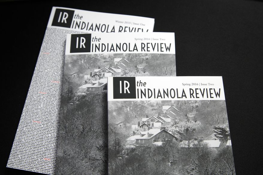 In this Jan. 24, 2017 photo, copies of the Indianola Review are displayed in Danny Judge's home office in Indianola, Iowa. Judge began writing the literary journal while his wife underwent chemotherapy. (Zach Boyden-Holmes/The Des Moines Register via AP  )