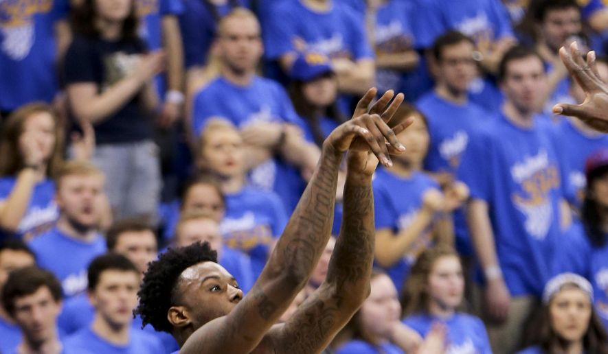Pittsburgh's Jamel Artis (1) shoots for three points against Florida State from the corner in front of the student section during the first half of an NCAA college basketball game, Saturday, Feb. 18, 2017, in Pittsburgh. (AP Photo/Keith Srakocic)